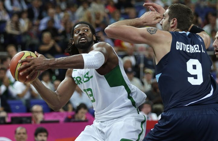 Brazil's Nene Hilario, drives to the basket against Argentina's Juan Gutierrez during a men's quarterfinals basketball game at the 2012 Summer Olympics, Wednesday, Aug. 8, 2012, in London. (AP Photo/Charles Krupa)