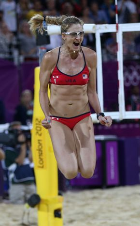 United States' Kerri Walsh Jennings celebrates after winning the women's gold medal beach volleyball match against the other US team at the 2012 Summer Olympics, Wednesday, Aug. 8, 2012, in London. (AP Photo/Petr David Josek)