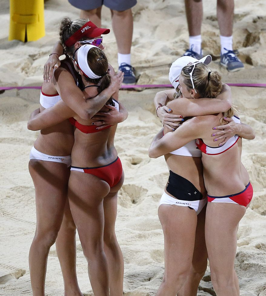 United States' Kerri Walsh Jennings, right, and Misty May-Treanor, second from left, hug United States' April Ross, left, and Jennifer Kessy after a women's gold medal beach volleyball match at the 2012 Summer Olympics, London, Wednesday, Aug. 8, 2012. Kerri Walsh Jennings and Misty May-Treanor won the match. (AP Photo/Jae C. Hong)