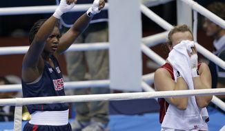 Claressa Shields (left) of the United States celebrates her victory over Kazakhstan's Marina Volnova in a middleweight 75 kg semifinal boxing match at the 2012 Summer Olympics in London on Wednesday, Aug. 8, 2012. (AP Photo/Patrick Semansky)