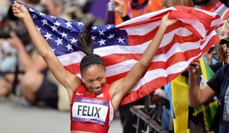 United States'  Allyson Felix celebrates her win in the women's 200-meter final during the athletics in the Olympic Stadium at the 2012 Summer Olympics, London, Wednesday, Aug. 8, 2012. (AP Photo/Martin Meissner)