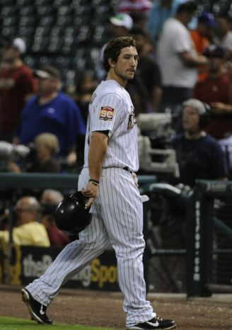 Houston Astros' Brett Wallace walks off the field after flying out with two men on base to give the Washington Nationals a 3-2 win in the 12th inning of a baseball game Tuesday, Aug. 7, 2012, in Houston. (AP Photo/Pat Sullivan)