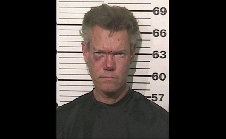 Country singer Randy Travis is pictured after being charged with driving while intoxicated near Tioga, Texas, late on Tuesday, Aug. 7, 2012. (AP Photo/Grayso