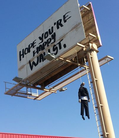 A billboard with a mannequin dangling from a hangman's noose near the Strip in Las Vegas. Authorities said calls began coming in early Aug. 8, 2012, from drivers worried the dummy along Interstate 15 near was a real person. A Nevada Highway Patrol spokesman said the sign is a publicity stunt done in bad taste. (Associated Press/KVVU)