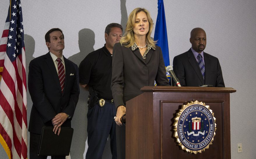 Teresa Carlson, FBI special agent in charge in Milwaukee, speaks at a press briefing in Milwaukee on Wednesday, Aug. 8, 2012, about the mass shooting at the Sikh Temple of Wisconsin on Sunday. (AP Photo/Tom Lynn)