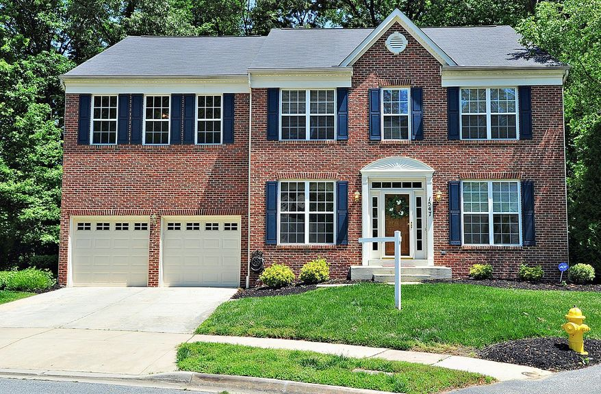 The home at 1547 Hornbeam Drive in Crofton is on the market for $635,000. The four-bedroom Colonial on a corner lot has a two-car garage and a large deck and backs to a golf course.
