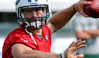 New York Jets quarterback Tim Tebow looks for a receiver during training camp in Cortland, N.Y. Tebow makes his debut with the Jets on Friday in a preseason matchup against the Bengals. (Associated Press)