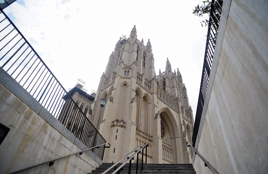 The Washington National Cathedral is viewed from the stairs leading up from its underground parking garage. Woodrow Wilson and his wife, Edith, are interred inside the cathedral, as are Helen Keller and Anne Sullivan. (Ryan M.L. Young/The Washington Times)