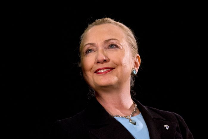Wearing a pin in the shape of Africa, Secretary of State Hillary Rodham Clinton finishes her speech about the U.S.-South Africa partnership on Wednesday, Aug. 8, 2012, at the University of the Western Cape in Cape Town, South Africa. (AP Photo/Jacq