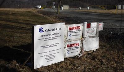 **FILE** A Cabot Oil & Gas wellhead in Dimock, Pa., is seen Feb. 13, 2012. (Associated Press)
