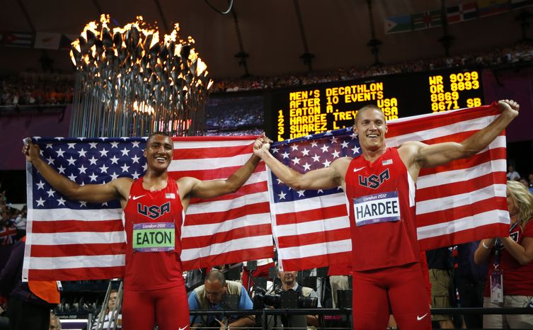 Gold medallist Ashton Eaton of the United States, left, and silver medallist Trey Hardee of the United States celebrate following the decathlon 1500-meter during the athletics in the Olympic Stadium at the 2012 Summer Olympics, London, Thursday, Aug. 9, 2012. (AP Photo/Matt Dunham)