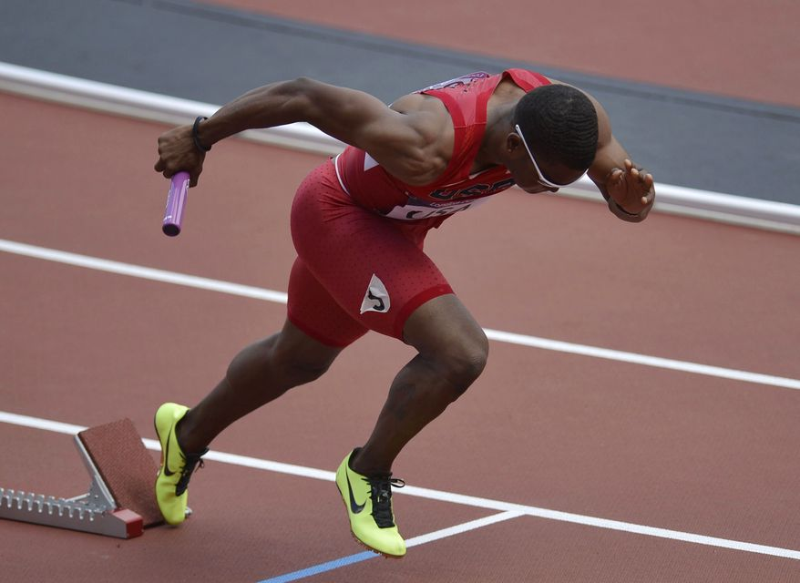 United States' Manteo Mitchell competes in a 4x400-meter relay heat during the athletics in the Olympic Stadium at the 2012 Summer Olympics, London, Thursday, Aug. 9, 2012. Manteo had half a lap to go in the first leg of the 4x400-meter relay preliminaries Thursday and a choice to make: keep running or stop and lose the race. To him, it was never much of a choice. He finished the lap and limped to the side to watch the Americans finish the race and qualify easily for the final. A few hours later, doctors confirmed what he suspected: He had run the last 200 meters with a broken left fibula. (AP Photo/Martin Meissner)