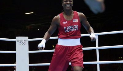 United States boxer Claressa Shields celebrates Aug. 9, 2012, after defeating Russia's Nadezda Torlopova for the women's middleweight 75-kg boxing gold medal at the 2012 Summer Olympics in London. (Associated Press)