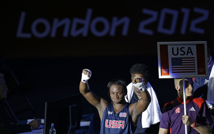 **FILE** United States' Claressa Shields reacts Aug. 8, 2012, after defeating Kazakhstan's Marina Volnova in a women's middleweight semifinal boxing match at the 2012 Summer Olympics in London. (Associated Press)