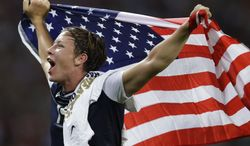United States' Abby Wambach celebrates after winning the women's soccer gold medal match against Japan at the 2012 Summer Olympics, Thursday, Aug. 9, 2012, in London. The United States won 2-1. (AP Photo/Lefteris Pitarakis)