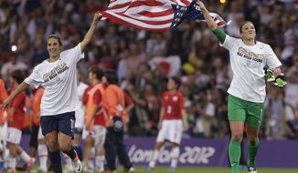 United States' Carli Lloyd, left, and United States goalkeeper Hope Solo celebrate after winning the women's soccer gold medal match against Japan at the 2012 Summer Olympics, Thursday, Aug. 9, 2012, in London.  The United States won 2-1. (AP Photo/Julie Jacobson)