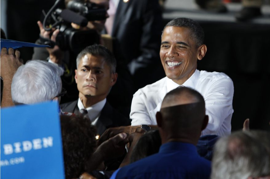 President Obama greets supporters Aug. 9, 2012, after a campaign event at the Colorado State Fairgrounds in Pueblo, Colo. (Associated Press)