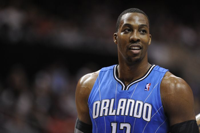 **FILE** Orlando Magic's Dwight Howard walks on the court April 7, 2012, during a break in play during the Magic's 88-82 road win against the Philadelphia 76ers. (Associated Press)
