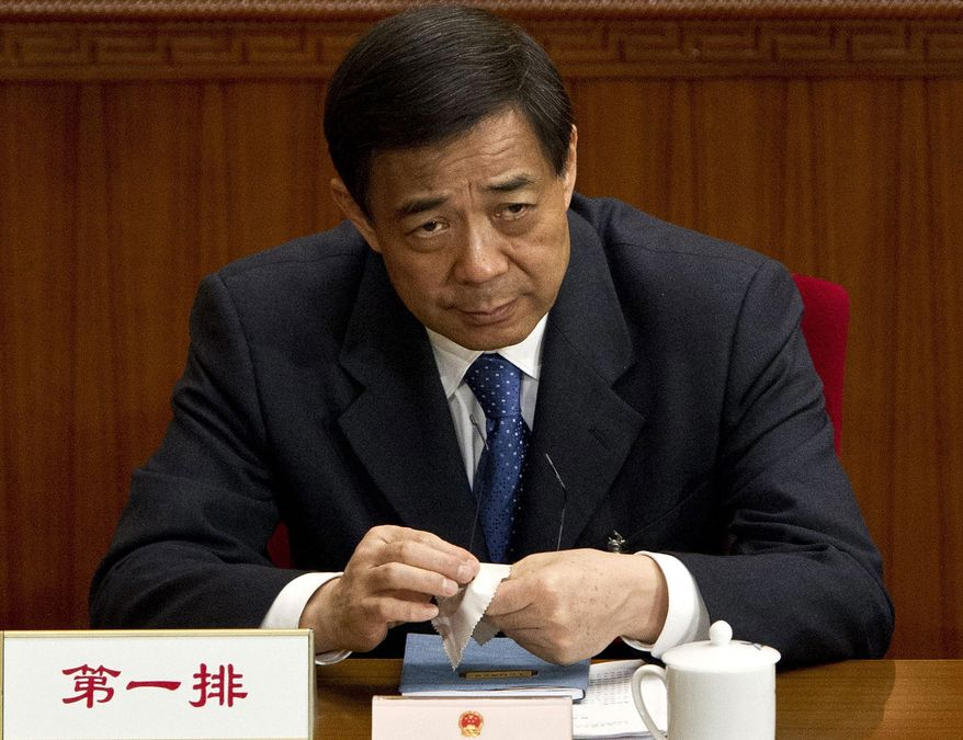 ** FILE ** Bo Xilai, then the Chongqing Communist Party secretary, attends a plenary session of the National People's Congress at the Great Hall of the People in Beijing on Sunday, March 11, 2012. (Associated Press)