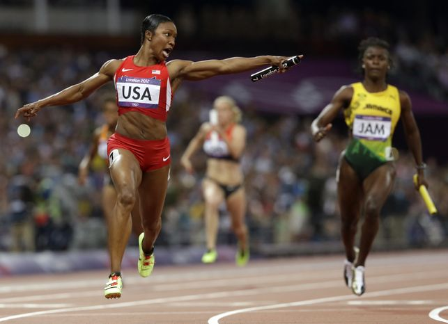 United States' Carmelita Jeter reacts as she crosses the finish line to win the women's 4x100-meter relay at the 2012 Summer Olympics, London, Friday, Aug. 10, 2012. The United States relay team set a new world record with a time of 40.82 seconds. (AP Photo/Anja Niedringhaus)