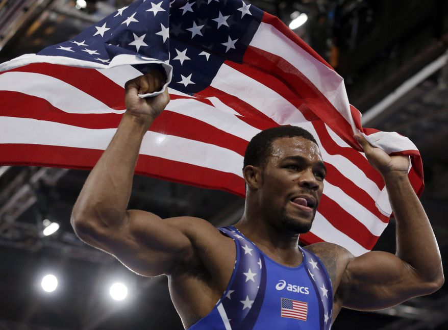 ** File ** United States' Jordan Ernest Burroughs, celebrates after winning against Iran's Sadegh Saeed Goudarzi after the gold medal match at a 74-kg men's freestyle wrestling competition at the 2012 Summer Olympics, Aug. 10, 2012, in London. (Associated Press)