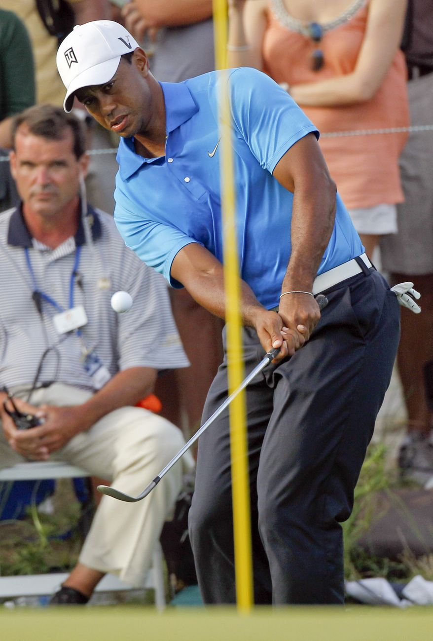 Tiger Woods chips to the 16th green during the second round of the PGA Championship golf tournament on the Ocean Course of the Kiawah Island Golf Resort in Kiawah Island, S.C., Friday, Aug. 10, 2012. (AP Photo/Evan Vucci)