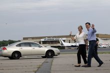 Republican presidential candidate, former Massachusetts Gov. Mitt Romney, and his wife Ann wave at reporters as they arrive in Norfolk, Va., Friday, Aug. 10, 2012. (AP Photo/Mary Altaffer)