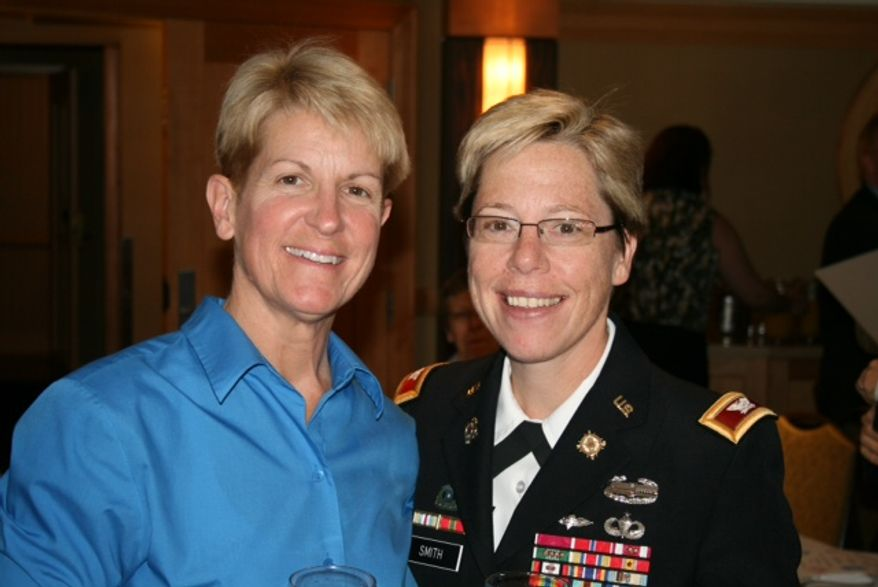 Army Brig. Gen. Tammy Smith (right) became the military's first openly gay flag officer when she was promoted to her current rank in an Aug. 10, 2012, ceremony. She received her new decorations from her wife, Tracey Hepner (left). (Servicemembers Defense Legal Network)