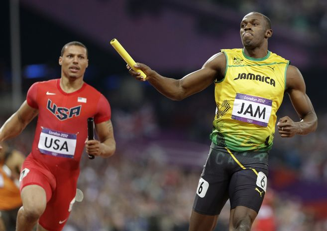 Jamaica's Usain Bolt leads United States' Ryan Bailey to win the men's 4x100-meter relay final during the athletics in the Olympic Park during the 2012 Summer Olympics, Saturday, Aug. 11, 2012, in London. Jamaica set a new world record with a time of 36.84 seconds.(AP Photo/Anja Niedringhaus)