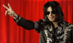 ** FILE ** Pop star Michael Jackson announcing his upcoming concert dates during press conference at the London O2 Arena on March 5, 2009. (AP Photo/Joel Ryan)