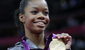 FILE- In this Thursday, Aug. 2, 2012, file photo, U.S. gymnast Gabrielle Douglas displays her gold medal during the artistic gymnastics women's individual all-around competition at the 2012 Summer Olympics, in London. With the gymnastics competition over, the U.S. women's gymnastics team is beginning to realize just how big a deal they've become back home. (AP Photo/Julie Jacobson)