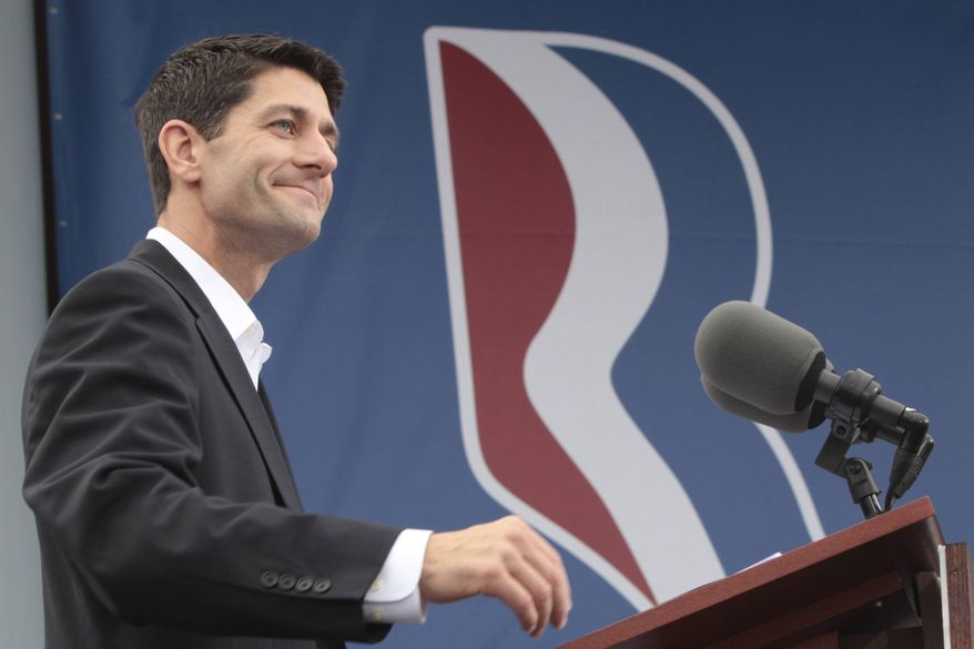 Rep. Paul Ryan of Wisconsin, who was named as announced Republican presidential candidate Mitt Romney's running mate, addresses a crowd Aug. 11, 2012, during a campaign event with Romney in Norfolk, Va. (Associated Press)