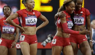 United States' women's 4 X400-meter relay team from left, Francena McCorory, Allyson Felix, Sanya Richards-Ross and Deedee Trotter celebrate after winning the gold medal during the athletics in the Olympic Stadium at the 2012 Summer Olympics, London, Saturday, Aug. 11, 2012. (AP Photo/Anja Niedringhaus)