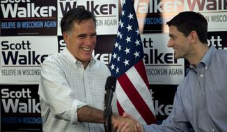 ** FILE ** Republican presidential candidate, former Massachusetts Gov. Mitt Romney, left, shakes hands with U.S. Rep. Paul Ryan, R-Wis., chairman of the House Budget Committee, right, before speaking with supporters of Wisconsin Republican Gov. Scott Walker at a phone bank during a campaign stop in Fitchburg, Wis., in this March 31, 2012, file photo. (AP Photo/Steven Senne, File)
