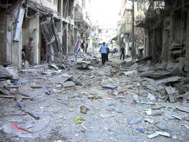 This image made from amateur video released by the Shaam News Network and accessed Saturday, Aug. 11, 2012, purports to show the destruction of houses by shelling from Syrian government forces in Damascus, Syria, Wednesday, Aug. 8, 2012. The Associated Press is unable to independently verify the authenticity, content, location or date of this handout photo. (AP Photo/Shaa
