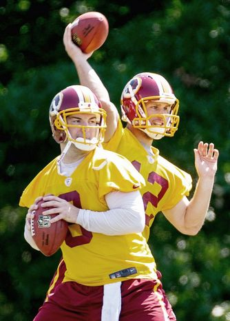Andrew Harnik/The Washington Times  Redskins quarterbacks Rex Grossman (front) and Kirk Cousins are tasked with staying sharp as backups to rookie Robert Griffin III.