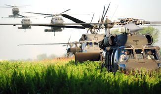**FILE** U.S. Army UH-60 Black Hawk helicopters arrive to pick up soldiers during an exercise at Fort Campbell, Ky., for Week of the Eagles.
