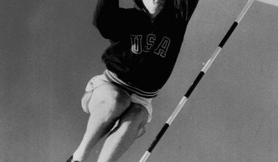 Bob Mathias goes over the bar during a pole-vault session during the Olympics in Helsinki in 1952. (Associated Press)
