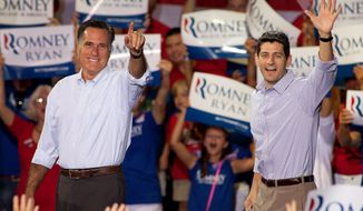 Mitt Romney (left), the presumptive Republican presidential nominee, and Rep. Paul Ryan, his running mate, arrive at a campaign rally in Mooresville, N.C., at the NASCAR Technical Institute on Sunday, Aug. 12, 2012. (Associated Press)