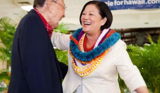 Democrat Rep. Mazie Hirono, right, hugs U.S. Senator Daniel Inouye after Hirono won the Democratic primary nomination for a Hawaii seat in the U.S. Senate, Saturday, Aug. 11, 2012 in Honolulu. (AP Photo/Marco Garcia)