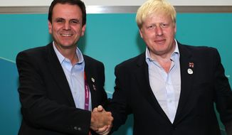Mayor of London Boris Johnson, right, shakes the hand of Mayor of Rio de Janeiro, Eduardo Paes, during a press conference in London to outline how London is working with the Brazilian city to ensure a smooth handover when the London 2012 Olympic Games come to an end over the up-coming weekend, in London Friday, Aug. 10, 2012.  Rio de Janeiro is to host the 2016 Olympic Games.(AP Photo/Sang Tan)