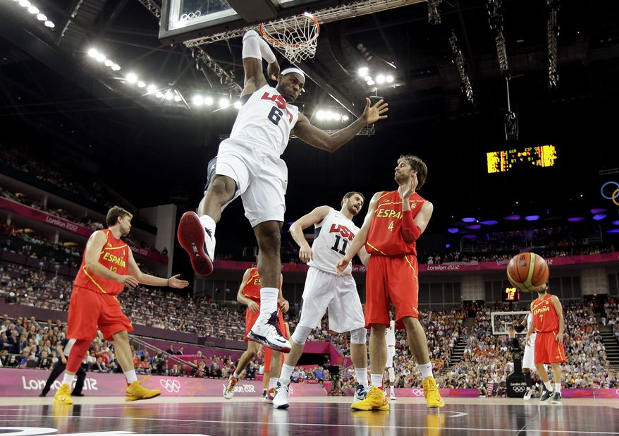 LeBron James of the United States dunks during the men's gold-medal basketball game against Spain at the 2012 Summer Olympics on Sunday, Aug. 12, 2012, in London. (AP Photo/Eric Gay)