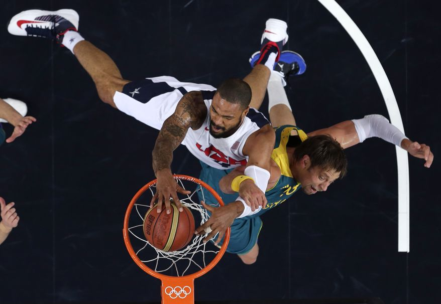 ** FILE ** Tyson Chandler of the United States dunks against Australia's David Andersen during a men's quarterfinals basketball game at the 2012 Summer Olympics in London on Wednesday, Aug. 8, 2012. (AP Photo/Charles Krupa)