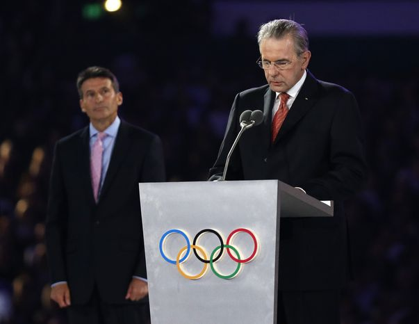 LOCOG Chairman Sebastian Coe, left, watches as President of the International Olympic Committee Jacques Rogge delivers a speech during the Closing Ceremony at the 2012 Summer Olympics, Monday, Aug. 13, 2012, in London. (AP Photo/Matt Dunham)