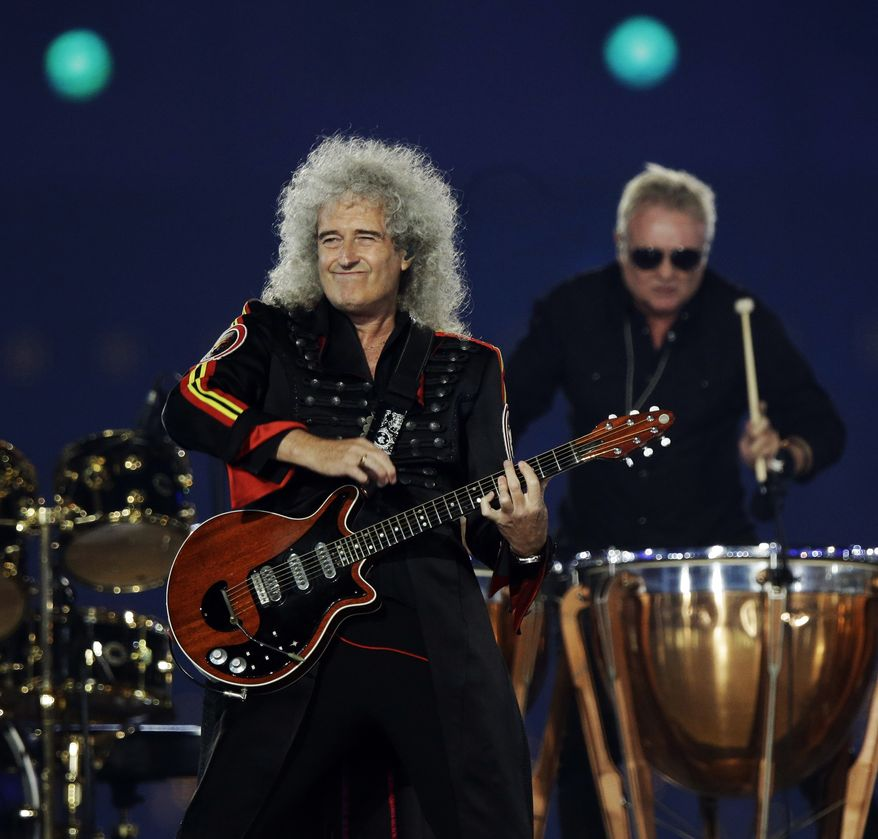 Brian May performs during the Closing Ceremony at the 2012 Summer Olympics, Sunday, Aug. 12, 2012, in London. (AP Photo/Charlie Riedel)