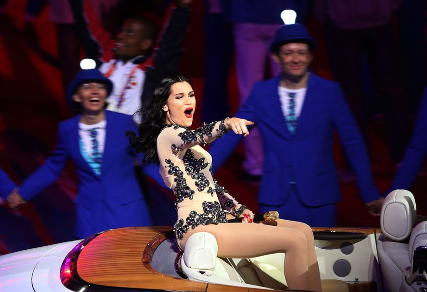 """British singer Jessie J performs """"Price Tag"""" during the Closing Ceremony at the 2012 Summer Olympics, Sunday, Aug. 12, 2012, in London. (AP Photo/Sergei Grits)"""