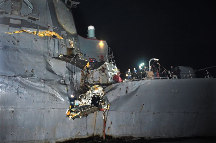 The USS Porter, a U.S. Navy guided-missile destroyer, was damaged in a collision with a Japanese-owned oil tanker just outside the strategic Strait of Hormuz on Sunday, Aug. 12, 2012. The collision left a gaping hole in the starboard side of the Porter, but no one was injured on either vessel, the Navy said. (AP Photo/U.S. Navy, Jonathan Sunderman)