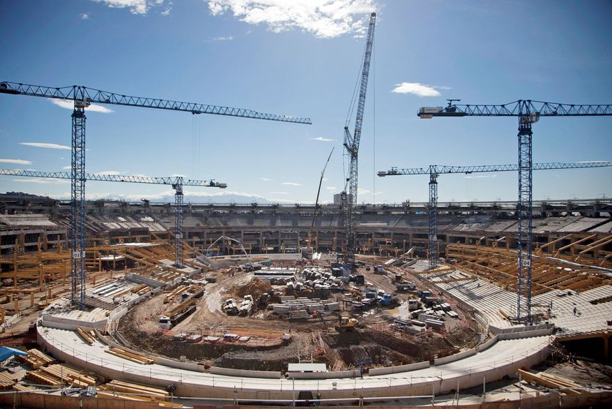 The Maracana stadium, built for the 2007 Pan American Games, is being upgraded for the 2014 World Soccer Cup and will need a costly renovation to host Olympic water polo and diving events. (Associated Press)