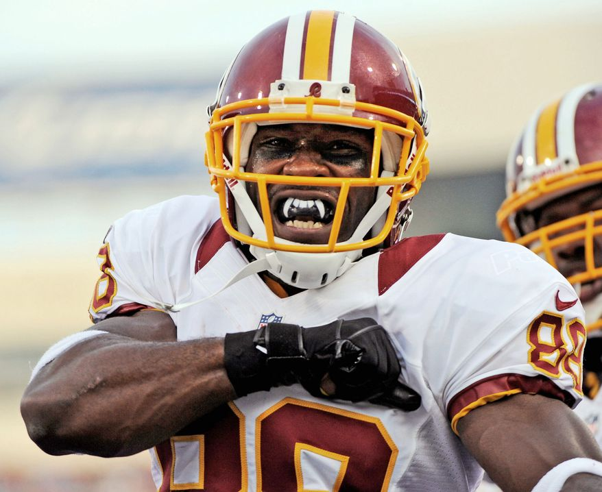 Redskins receiver Pierre Garcon celebrates his touchdown Thursday at Buffalo. Garcon caught three passes totaling 58 yards in the 80-yard drive. (Associated Press)