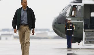 President Obama walks from Marine One to board Air Force One at O'Hare International Airport on Aug. 13, 2012, in Chicago, en route to Offutt Air Force Base in Bellevue, Neb., and onto a three-day campaign bus tour through Iowa. (Associated Press)